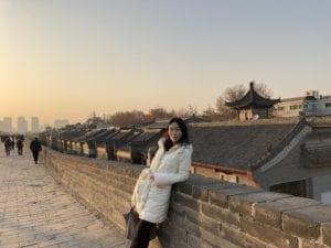 Yuan Liu standing on the Great Wall of China.